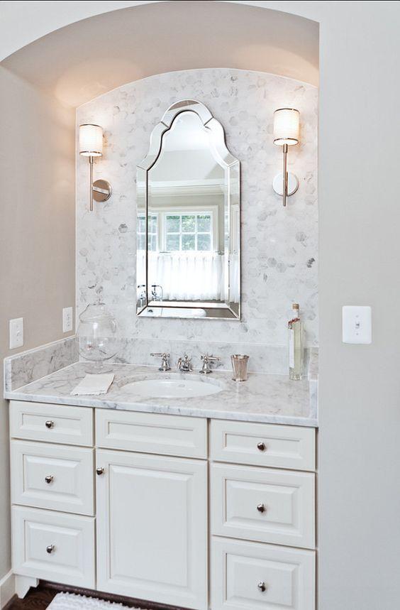 Powder Bath with Hex Marble Backsplash and White Cabinets via Homebunch