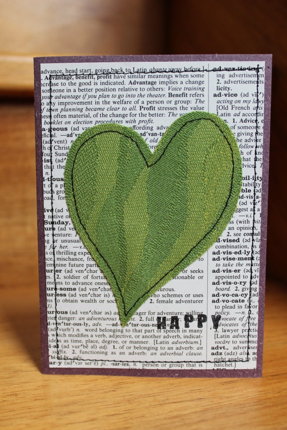 cute idea for simple heart art  Use a newspaper from a special day to make it even more special!