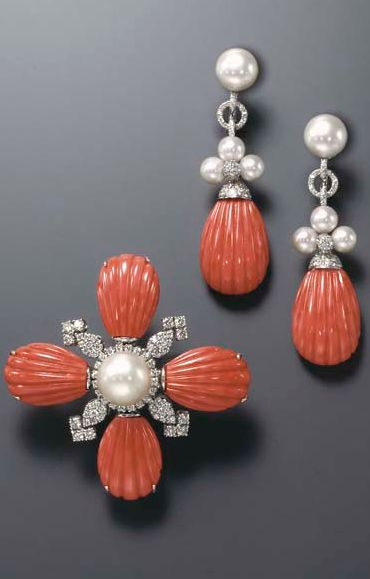 A SET OF CORAL AND CULTURED PEARL JEWELRY  Comprising a pendant brooch, centering upon a cultured pearl, measuring approximately 13.60 mm, within a circular-cut diamond surround, extending fluted coral terminals, spaced by circular-cut diamond cluster motifs; and a pair of ear pendants en suite, mounted in 18k white gold The total weight of the diamonds is approximately 3.10 carats