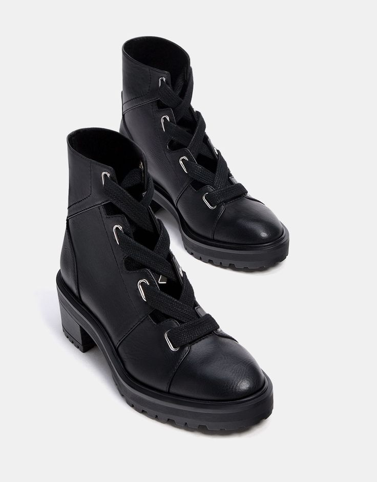 https://www.bershka.com/us/woman/shoes/combat-boots/openwork-ankle-boots-with-metal-eyelets-c1010248502p101304019.html?colorId=040