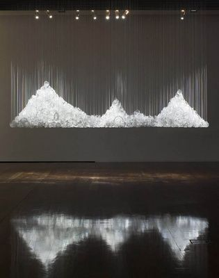 Australian artist Nicholas Folland makes incredible installations out of chandeliers found from thrift stores and eBay.