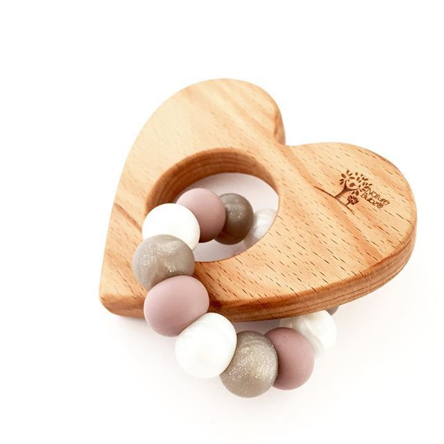 • Smoky Quartz • This amazing new colour is shimmery, glittery and very subtle in it's warm modern smoky grey tones. Shown here paired with Dusky Mauve and Pearl on our ever popular beech LOVE teether