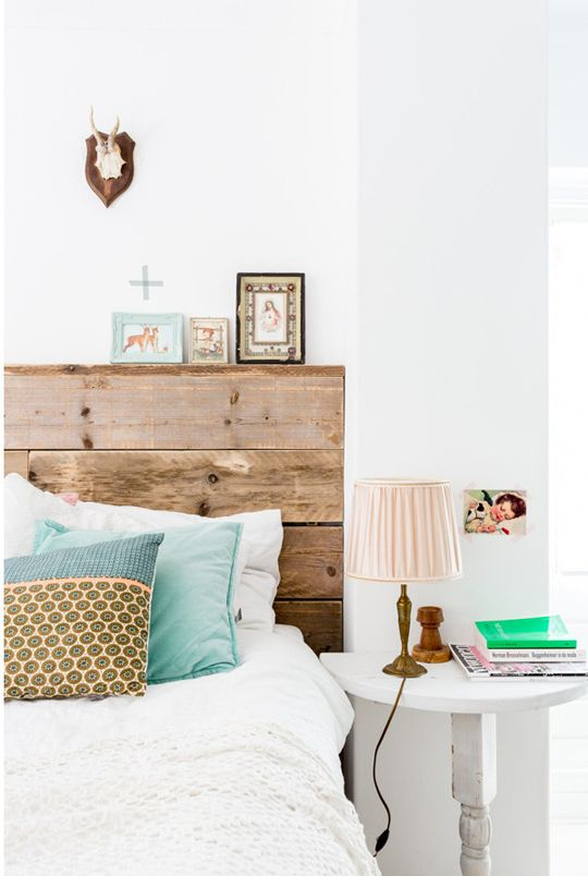 Can you spot the vintage Sacred Heart of Jesus postcard featured in this designer home decor photo? | Happy Family Decorating From Photographer Hans Mossel