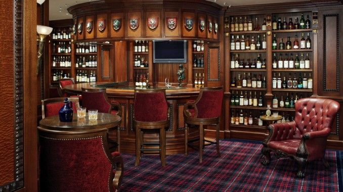 ultimate man cave bar. The garage bar  Or the ultimate Man Cave This guy s a real Scotch man His collection features 5500 bottles of Whiskey on display You can