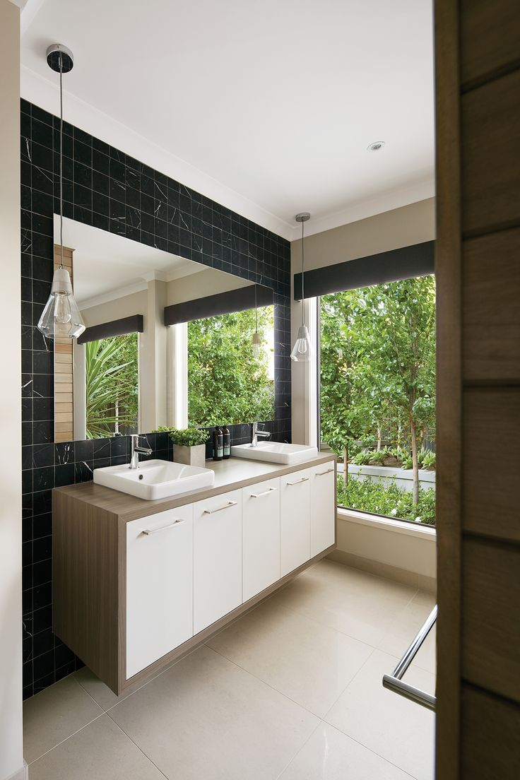 Layering natural materials and finishes such as warm timbers will help you create the perfect luxury, resort style bathroom.