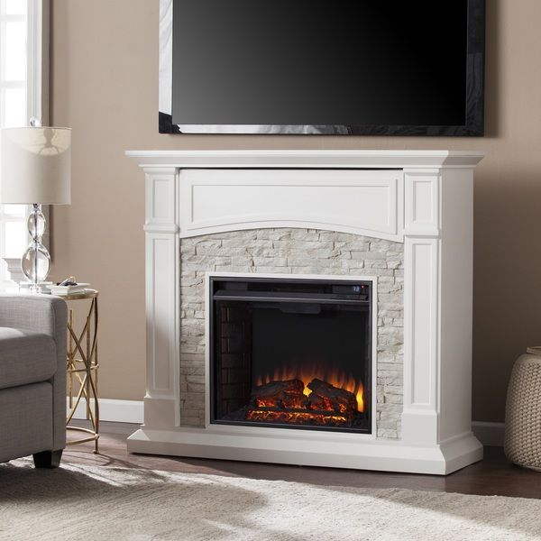 Add a chic farmhouse ambiance to your home with this media fireplace. Realistic stacked stone surrounds the firebox, adding a texture to the smooth white finish and woodworked detailing. Flip open the