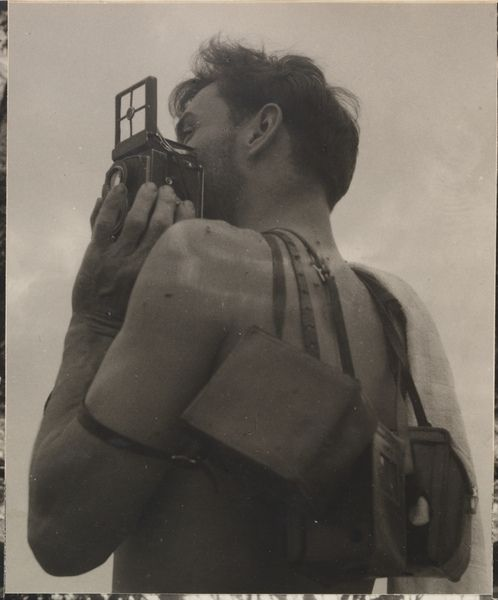 Max Dupain with his cameras by Olive Cotton - from Camping trips on Culburra Beach by Max Dupain and Olive Cotton 1937