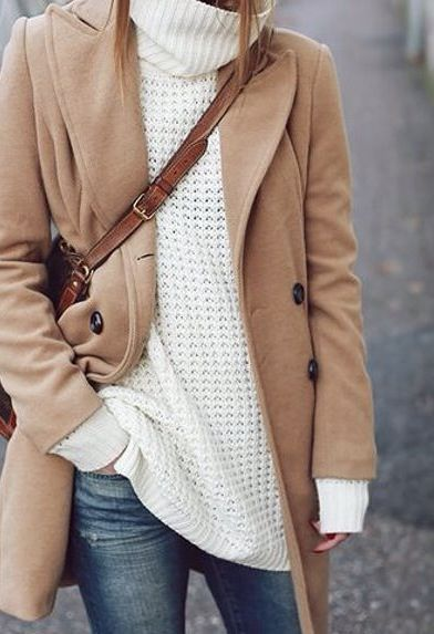 denim. chunky tneck. tan coat. crossbody bag.