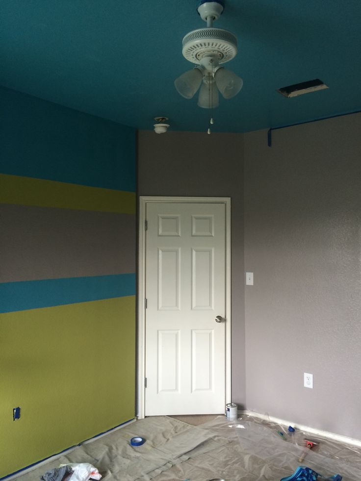 Green and blue striped accent wall in gray teen boy room for Boys room accent wall