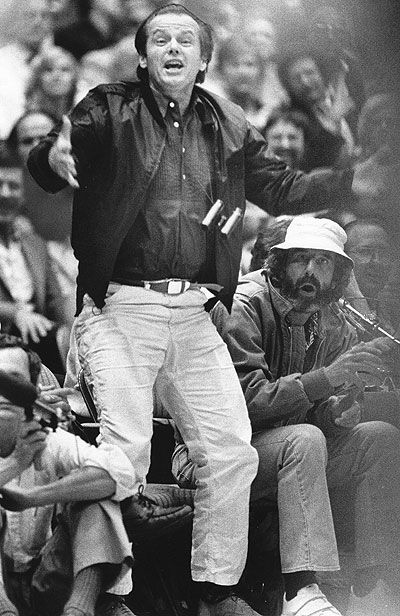 Jack Nicholson  ( Los Angeles Times / May 12, 1982 )    Jack Nicholson, who hardly ever holds back his emotions, takes in a game against the San Antonio Spurs while sitting next to music producer Lou Adler, right, in 1982.