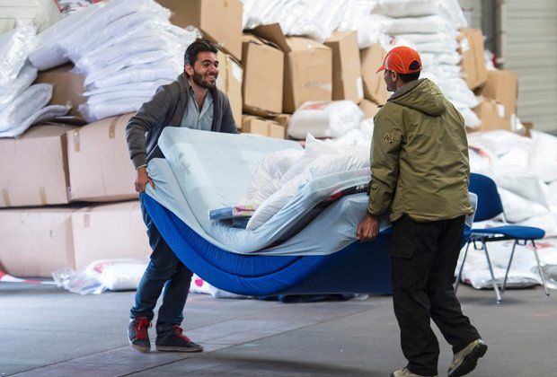 migrants getting things they need - so beautiful to know that people are being helped in their time of need and sorrow that they are forced to flee from their country