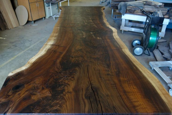"""An awesome Claro Walnut Single solid slab, 12' in length by 42"""" in width."""