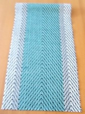 Hand woven turquoise- table runner (cotton/video cassette tape).