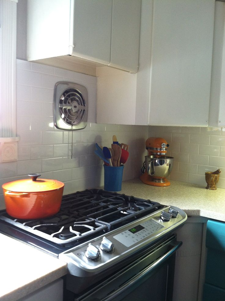 Subway Tile Kitchen Backsplash. Vintage Metal Kitchen Cabinets And Exhaust  Fan.