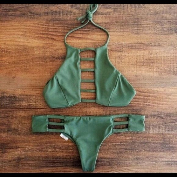 Navy Green Brazilian Bikini Navy green bikini. Size marked in swimsuit as medium but runs as if S. Super cute Brazilian bikini!  Coming Soon  Swim Bikinis