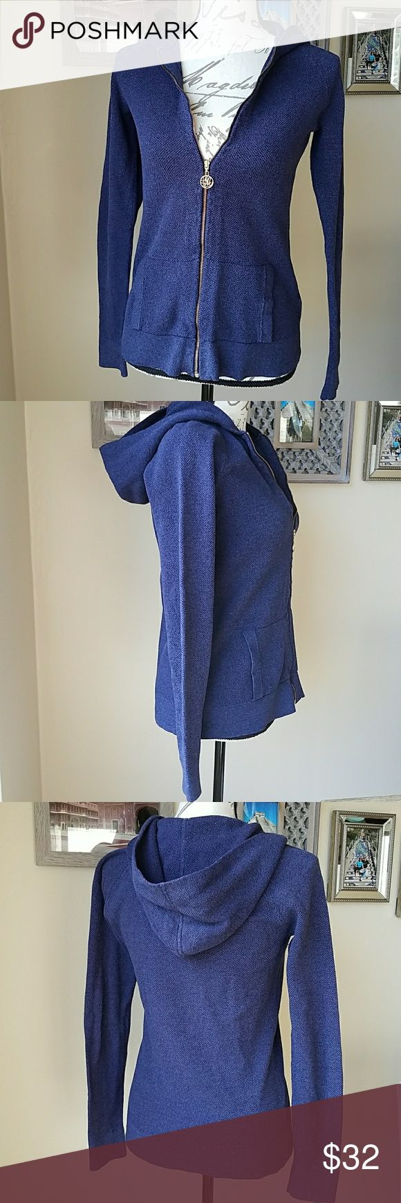 Lilly Pulitzer Zip Up Hoodie Classic fit long sleeve blue Lilly Pulitzer hoodie. Texture allover, front pockets and gold zip. 60% cotton, 24% viscose, 16% nylon. Length: 24', armpit to armpit: 16'. Pre loved but in very good conditions! Smoke free home. Lilly Pulitzer Sweaters Cardigans