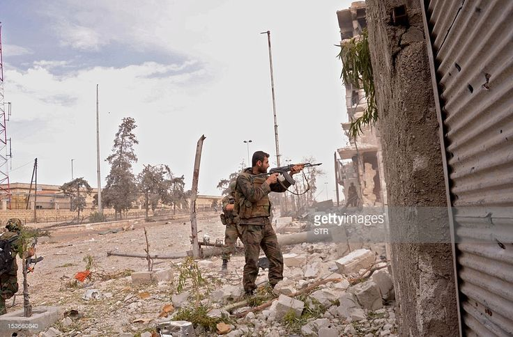 A unit of the Syrian armed forces carry out a military operation in the Khan al-Raslan neighbourhood of Syria's northern city of Aleppo, on October 8, 2012. UN Secretary General Ban Ki-moon warned of a 'dangerous' fallout from spiralling violence along the Syrian-Turkish border, as regime troops shelled rebel bastions across Syria leaving dozens dead.