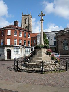 The market town of Fakenham in Norfolk, England sowing the war memorial and Fakenham Parish church, there has been a placeof worship on the site for ell over a thousand years.