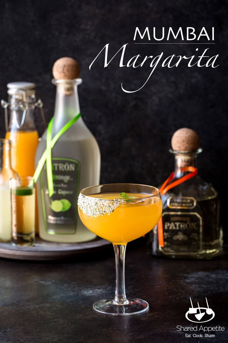 Mumbai Margarita inspired by the flavors of India with Patron tequila, mango puree, spicy rose water syrup, and lots of lime! #margarita #Cocktail