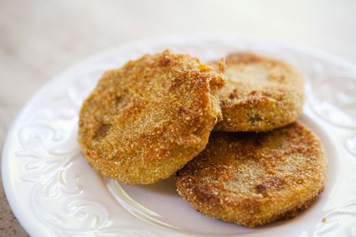 traditional fried green tomatoes.  sliced firm green tomatoes, dipped in egg and coated with flour, cornmeal and bread crumbs, fried and seasoned with salt and pepper.