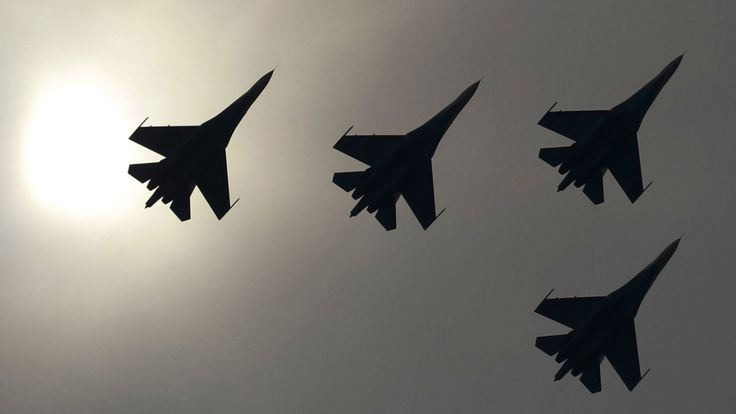 A Russian jet chased away a NATO aircraft after it tried to approach the defence minister's plane, according to a Russian news agency.