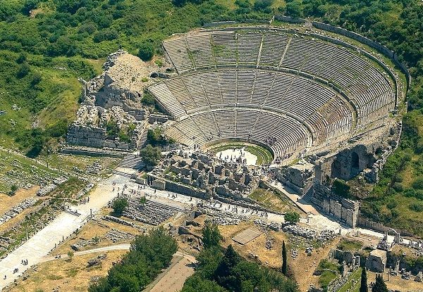 The Ancient Ruins of Ephesus City - To understand the magnificence of the Hellenistic Grand Theatre, imagine a fierce less gladiator looking to the audience of 24,000 spectators from centre stage.