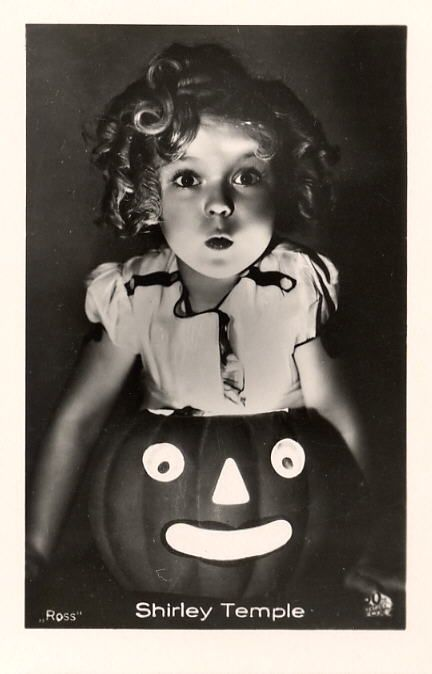 Shirley Temple looks adorable in this classic Halloween photo.