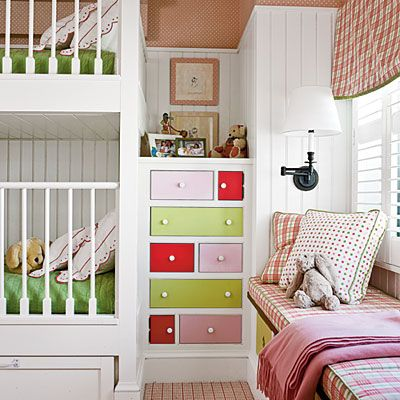 Cozy and Colorful    Designer T. Keller Donovan called attention to this built-in dresser by painted each drawers shades of coral, pink, and charteuse, which he pulled from the fabrics in the room. Drawers tucked beneath the window seat and the lowest bunk add additional storage