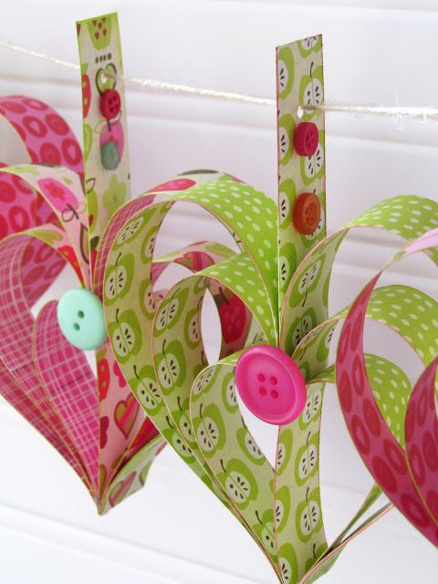 Heart Garland Tutorial {ribbonsandglue.com} I've seen this done with old book pages...sweet idea for wedding garland! :)