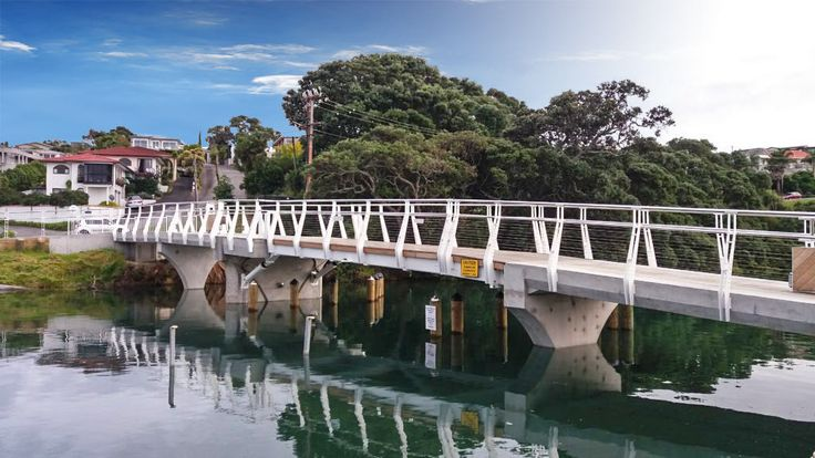 Milford Marina Bascule Footbridge is a 40m long architectural bascule lifting bridge in Auckland. Rams lift a 10m bascule span for boats to pass underneath.