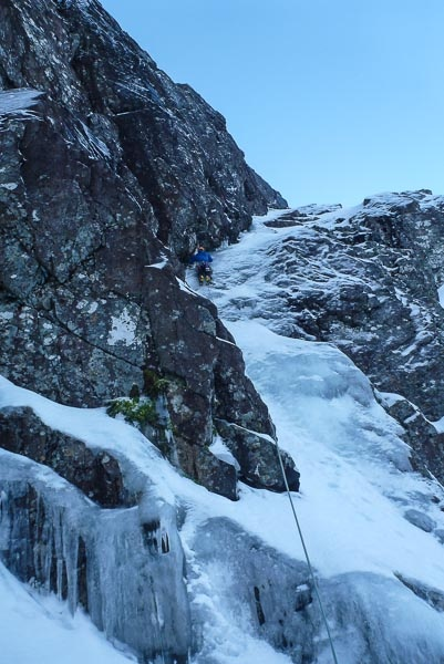 Blair Fyffe on the initial ramp of The Copenhagen Interpretation (VI,7) on South Trident Buttress, Ben Nevis. This route benefitted from icy conditions – The Ben has been particularly icy at mid-altitude elevations over the last couple of weeks, and the current fluctuating temperatures should continue to see the ice building over the coming days. (Photo Helen Rennard)