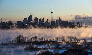 Mist rises from Lake Ontario in front of the Toronto skyline during extreme cold weather.