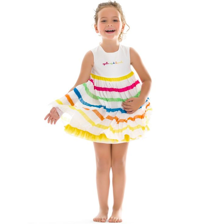 Girls, lovely sleeveless dress by Agatha Ruiz de la Prada with a white cotton bodice and pleated chiffon skirt.The designer's logo is embroidered across the bodice in bright colours and the skirt has matching stripes running all around. The dress is fully lined with a yellow tulle trim at the hem, giving extra fullness and has a fastener at the back withprinted,stripy, heart-shaped buttons.