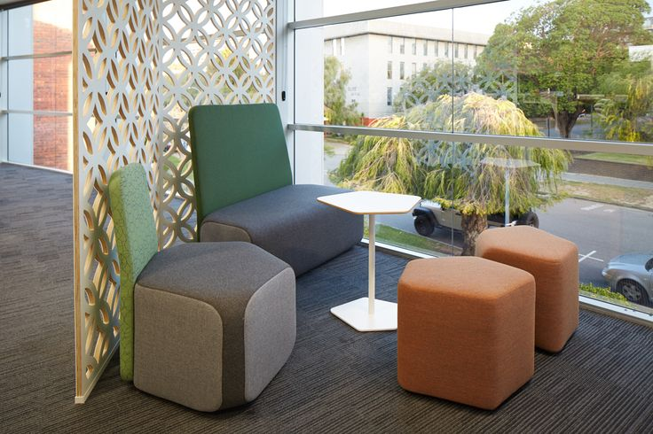 Sustainable Operator Dulcie on the ottomans! MKDC | MercyCare Office | Breakout Space