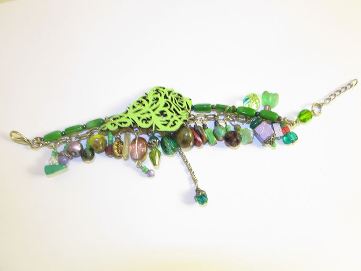 Handmade laser cut leather bracelet (1 pc)  Made with light green leather filigree, glass beads and chain.