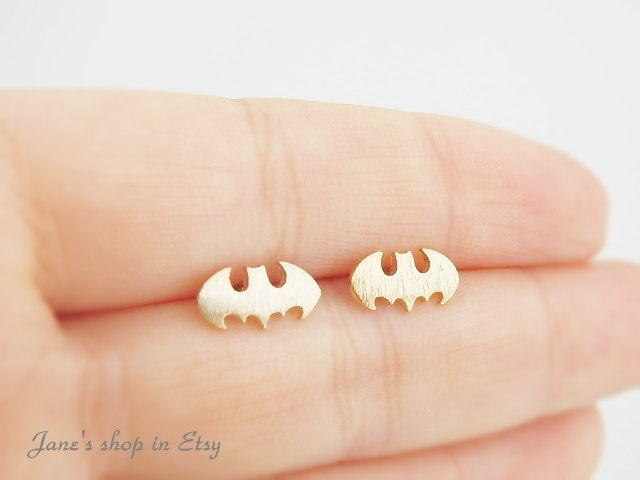 Gold batman studs with stering silver ear post, batman earrings, everyday jewelry, bridesmaid jewelry, minimalist jewelry. $13.50, via Etsy.
