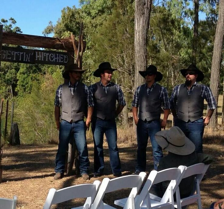 The groom, groomsmen, our handmade arch and sign.