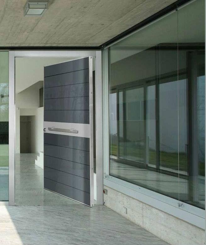 ΠΟΡΤΕΣ ΑΣΦΑΛΕΙΑΣ Golden Door :: Αξονική πόρτα ασφαλείας με επένδυση από μαύρο security τζάμι και inox.