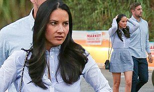 Olivia Munn and her NFL boyfriend Aaron Rodgers sport matching outfits #DailyMail