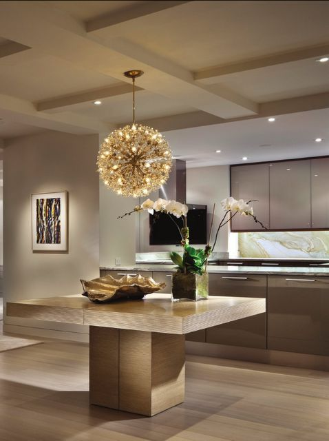 So modern, great use of space.  Unbelieveable island slab, great color scheme, and fantastic chandelier