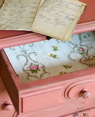 The interior of a drawer with vintage wallpaper. The cabinet was painted by Annie Sloan with Chalk Paint® in Scandinavian Pink, with a wash of French Linen.