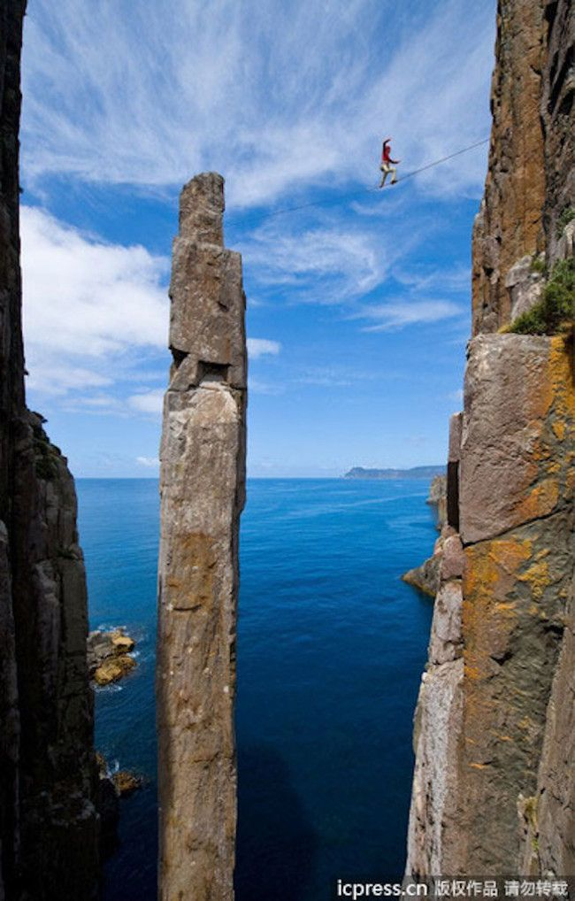 Located in Cape Hauy, Tasmania, the Totem Pole is a natural rock formation known as a sea or coastal stack, towering 65 meters into the sky. Australian photographer Simon Carter captured these photos of climbers tackling the iconic landmark.