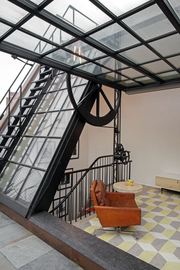West Village Townhouse, New York, 2012, BWArchitects Massive metal windows, tan leather chair, The Rug Company