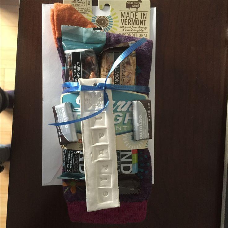 Gift idea for a teacher.  Socks, granola bars and chocolate.