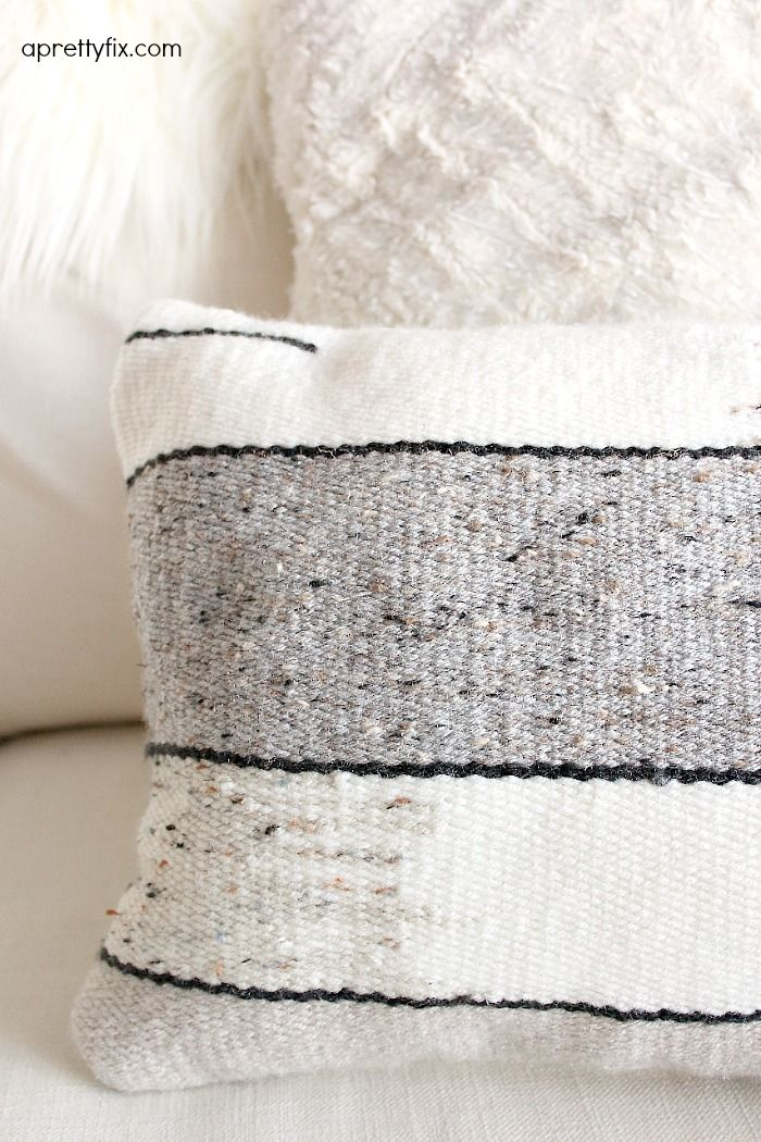 No sewing machine? No problem. Create this DIY Woven No-Sew Pillow with a basic loom, yarn, and pillow stuffing. A simple way to add a homemade touch to your home.