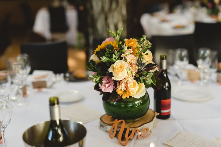 Table centerpiece. Gorgeous orange, peach and pink flowers.