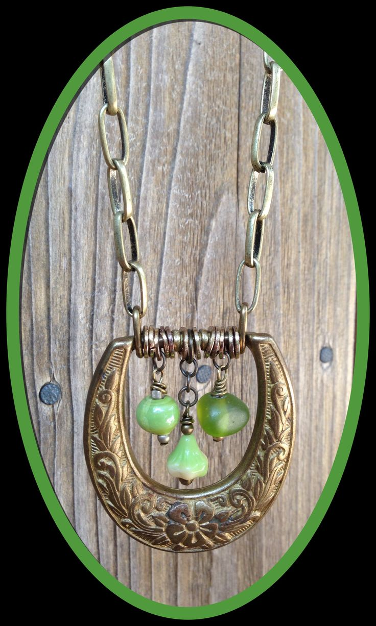 Brass belt buckle necklace with charms
