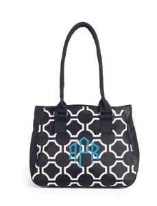 I LOVE this purse, It is the perfect size and so comfortable. Comes in 4 patterns and personalized for free. LOVE IT. Midtown from Initials Inc