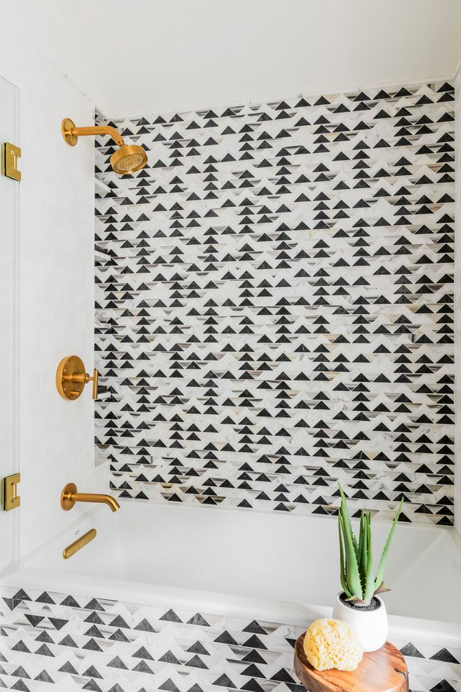 incredible black/white triangle tile in the bathroom