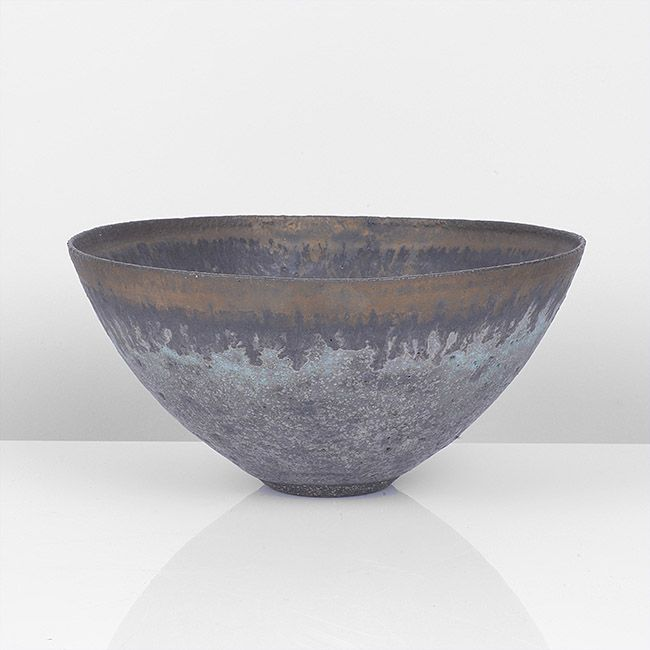 LUCIE RIE Bowl, circa 1980 Stoneware, pitted heather grey glaze with turquoise, a bronze band with manganese drips around the rim, impressed LR seal